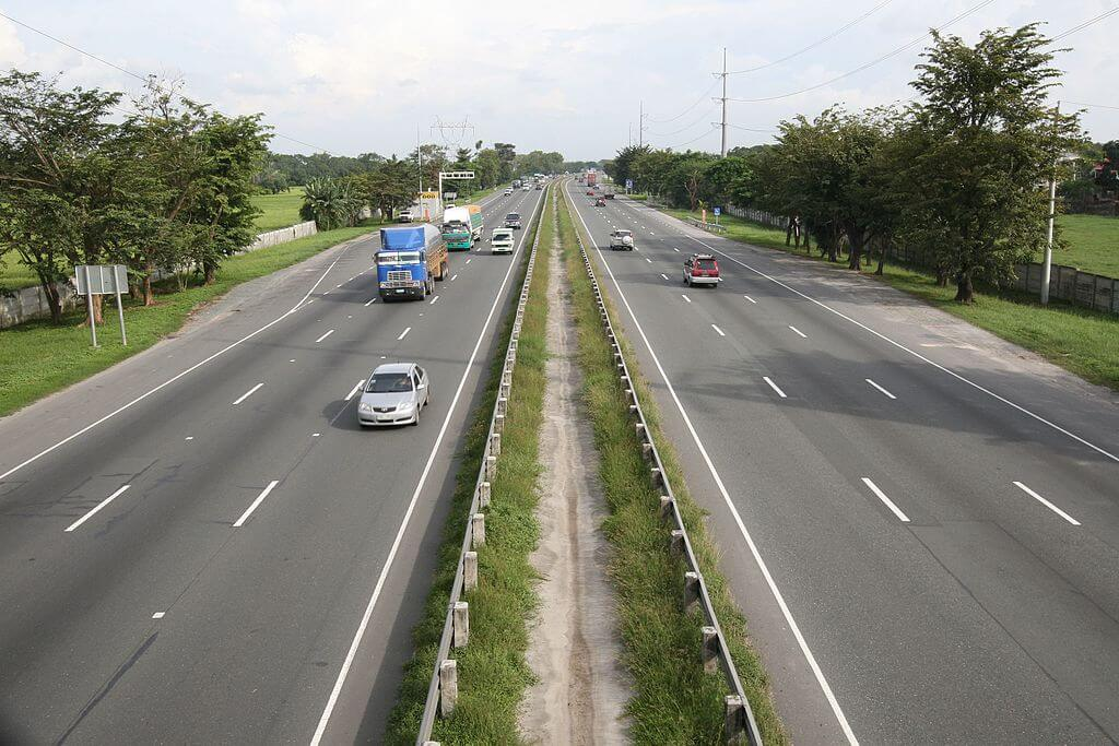Image of a highway with some cars